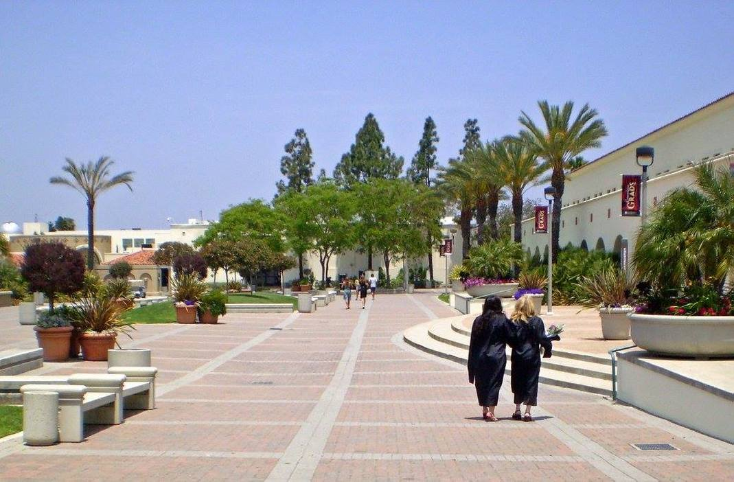 Picture of Poppy Fitch and Graduate Walking Across Campus